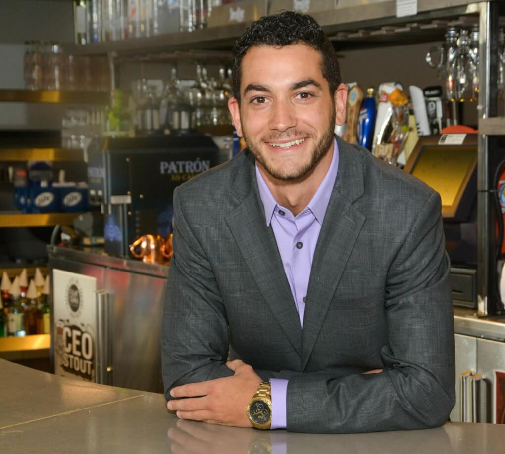 Davide Uccello is pictured  at one of his restaurants,  Flo�s Pizzeria Ristorante &  Sports Bar in Greenville.